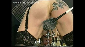 BDSM Pussy Labia Stretching Weight Torture Pissing in a Bucket Clamped Lips