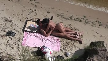 NUDIST BEACH. Nude young couple at the beach. Teen naked couple at the nudist beach. Naturist beac